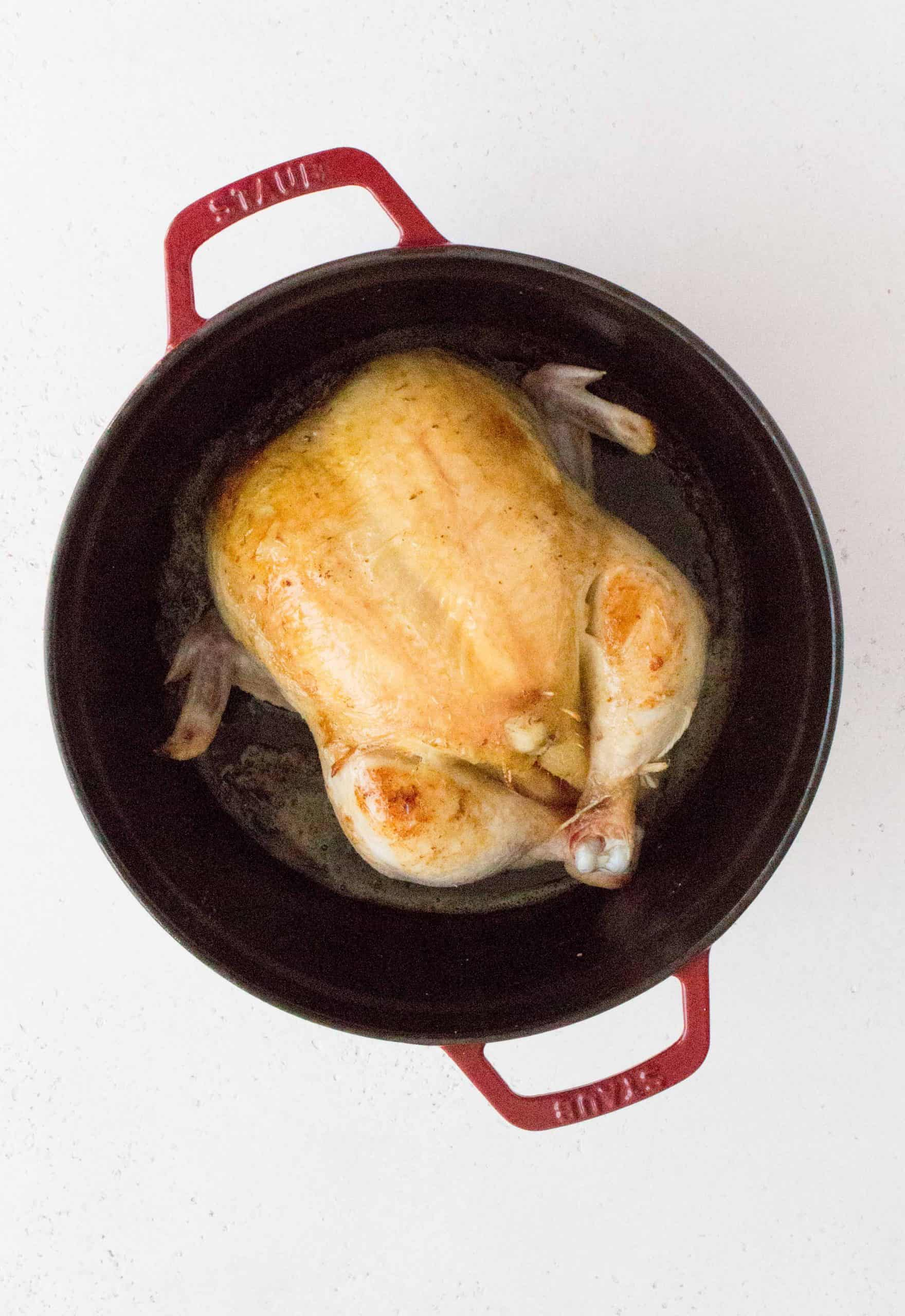 On medium-high heat, add in the olive oil to the Dutch oven, salt and brown the whole chicken, starting with breast side down then flipping it around 5-10 minutes or until the skin has turned golden brown.