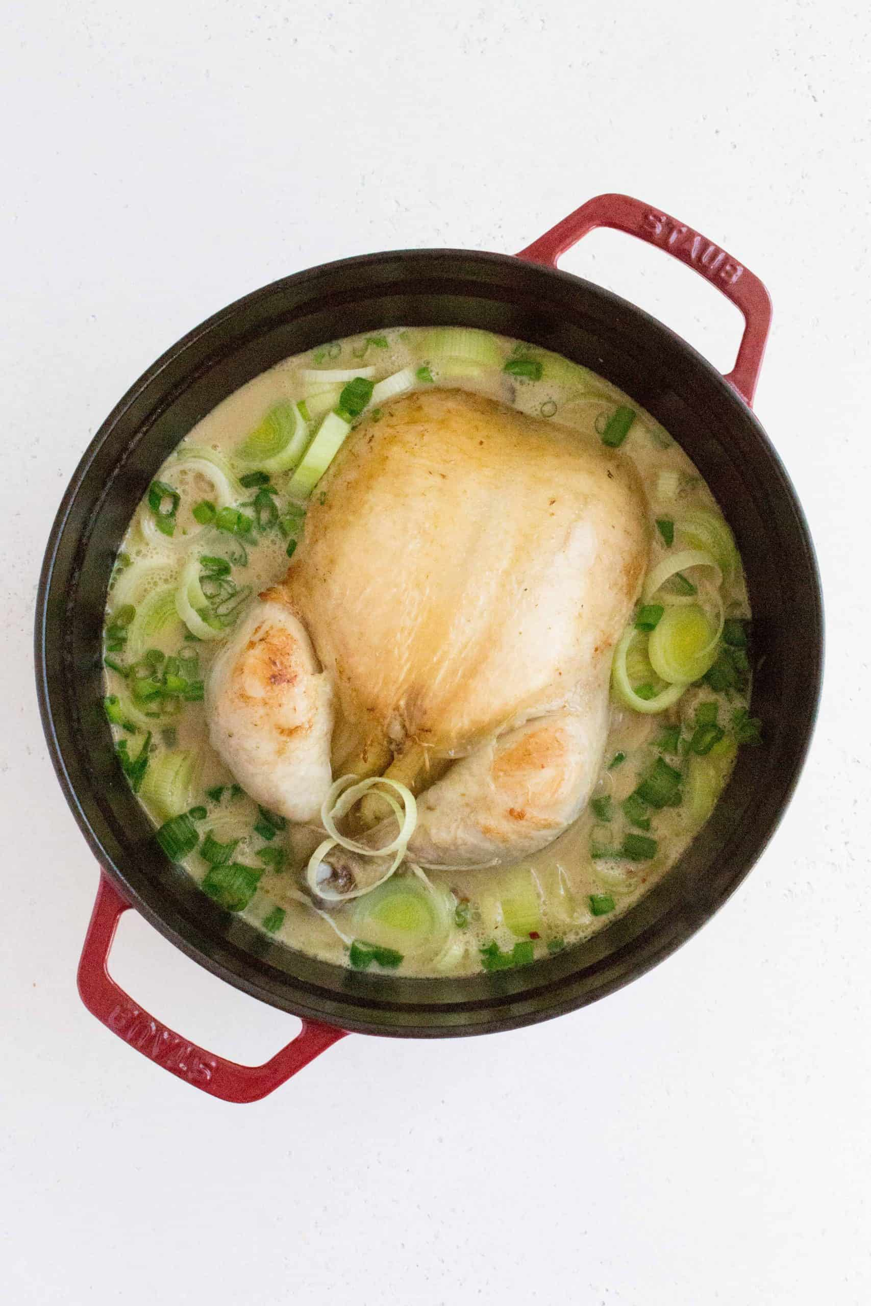 Uncover the pot, add in the leeks, lime juice + zest, and green onions. Simmer for another 10-15 minutes or until the chicken has cooked through. The safe internal temperature for cooked chicken is 165° F (75° C)