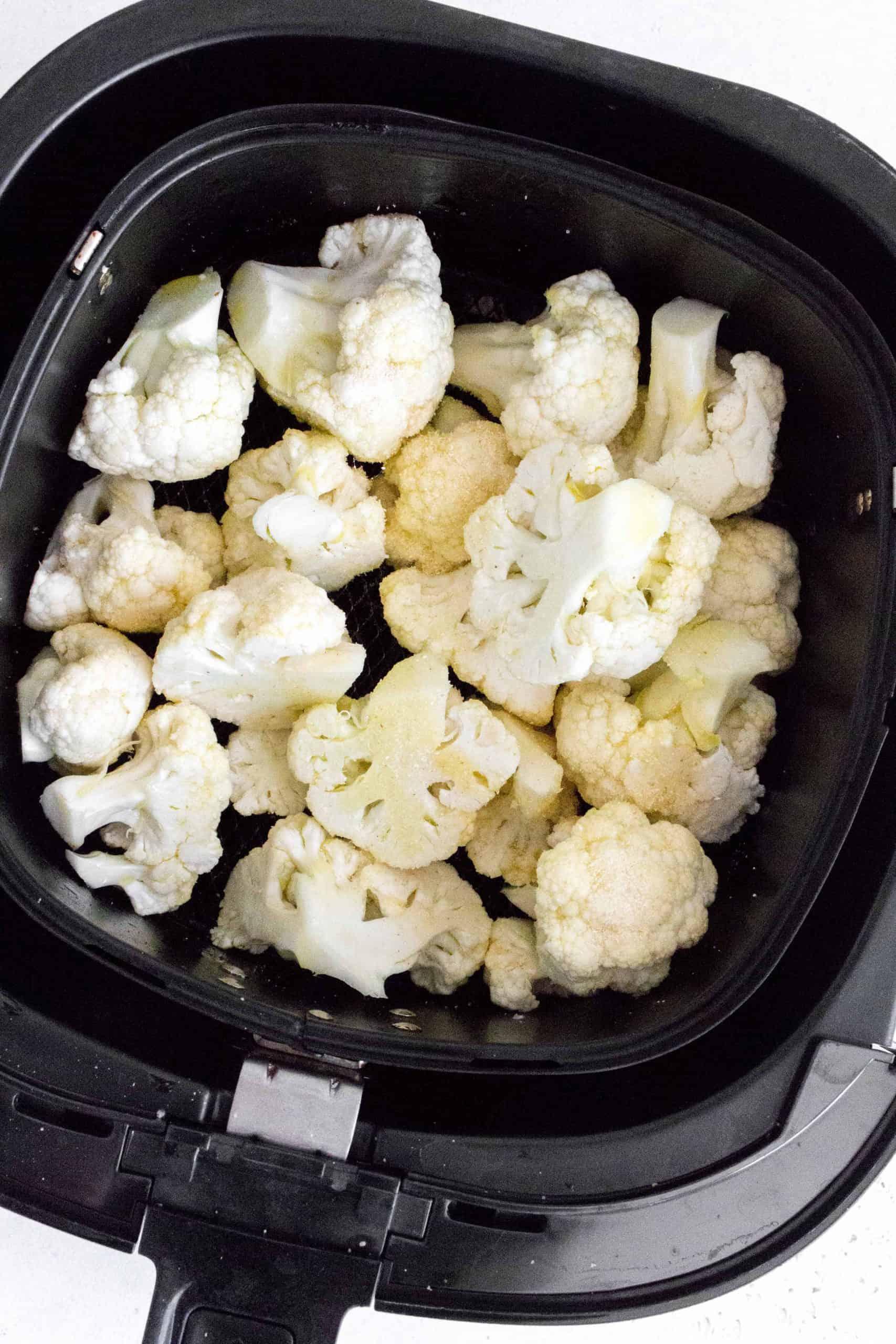 cauliflower inside an air fryer basket