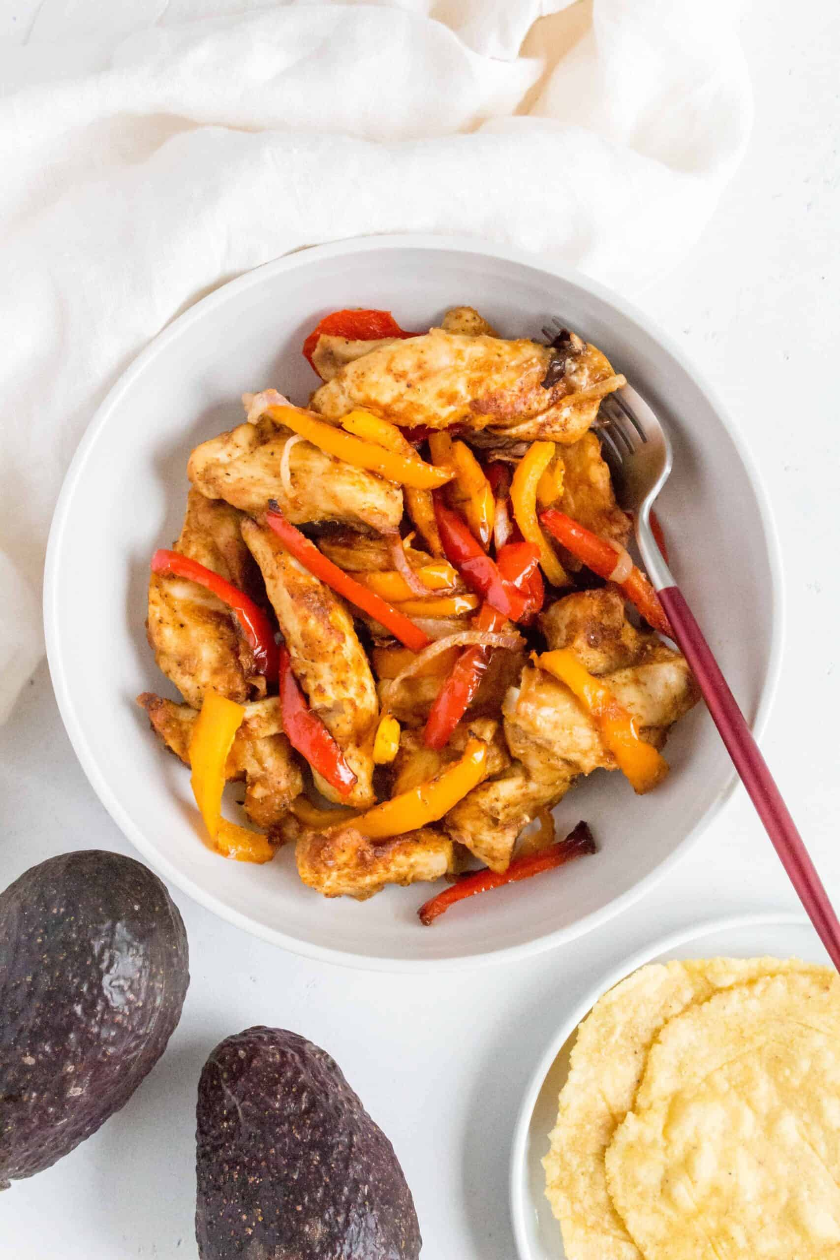 Have dinner ready on the table in less than 30 minutes with this quick and healthy Air Fryer Chicken Fajitas!