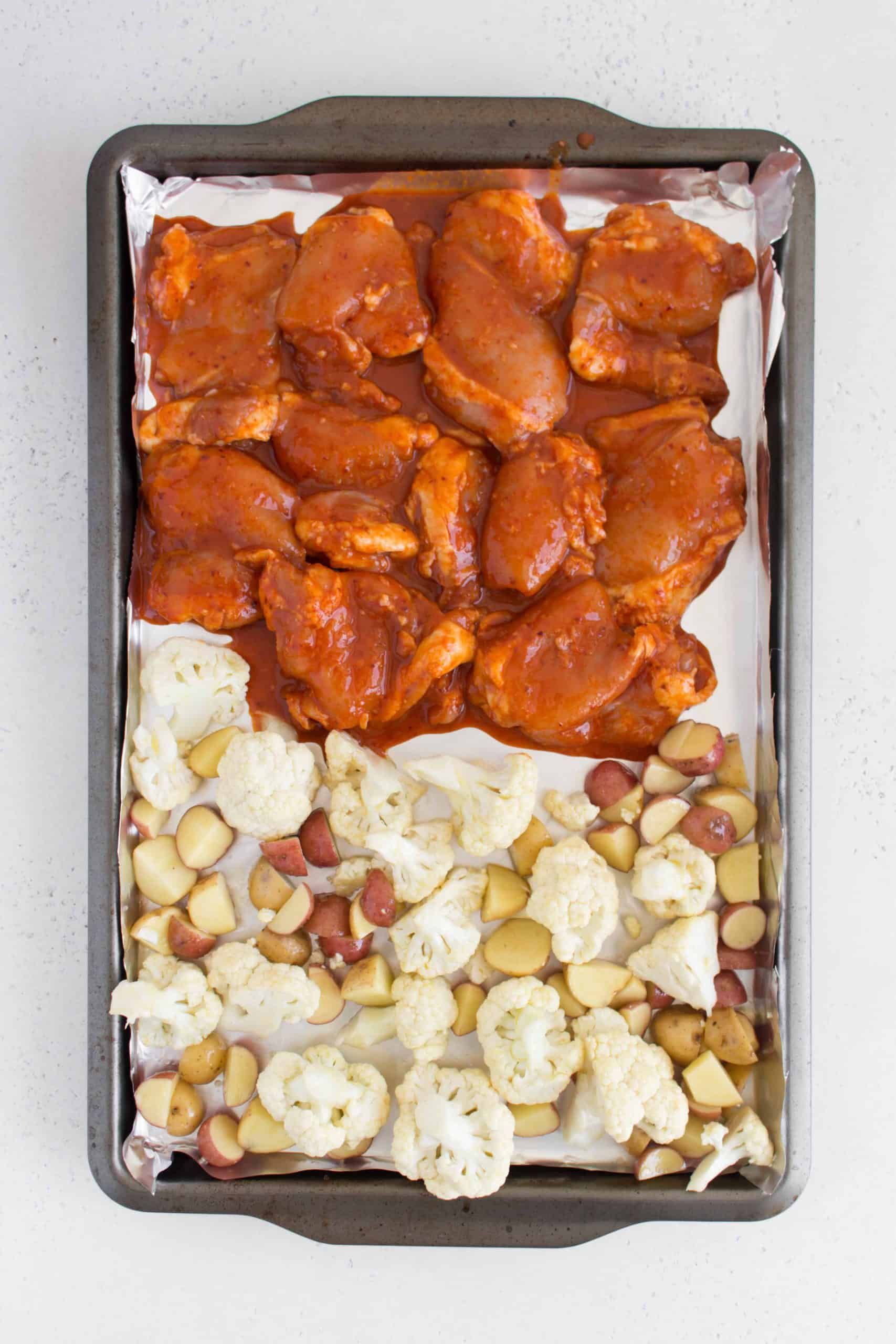 sheet pan with spicy korean chicken thighs with cauliflower and baby potatoes