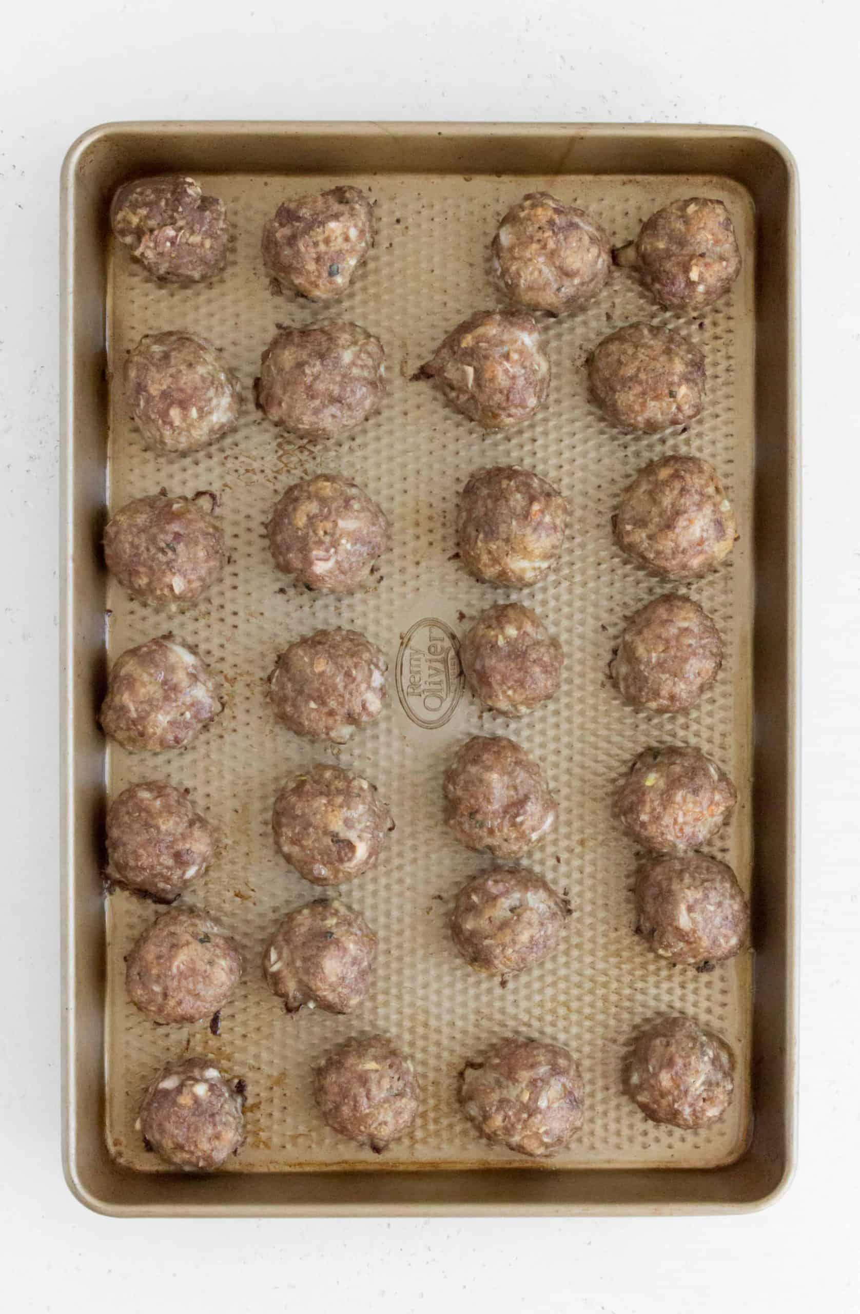 baked greek meatballs in a sheet pan