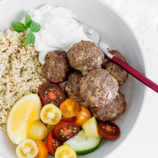 These healthy and delicious Greek Meatball served with a side of quinoa and tzatziki sauce are perfect dinner or meal prepping! The Greek meatballs are freezer friendly and full of flavour!