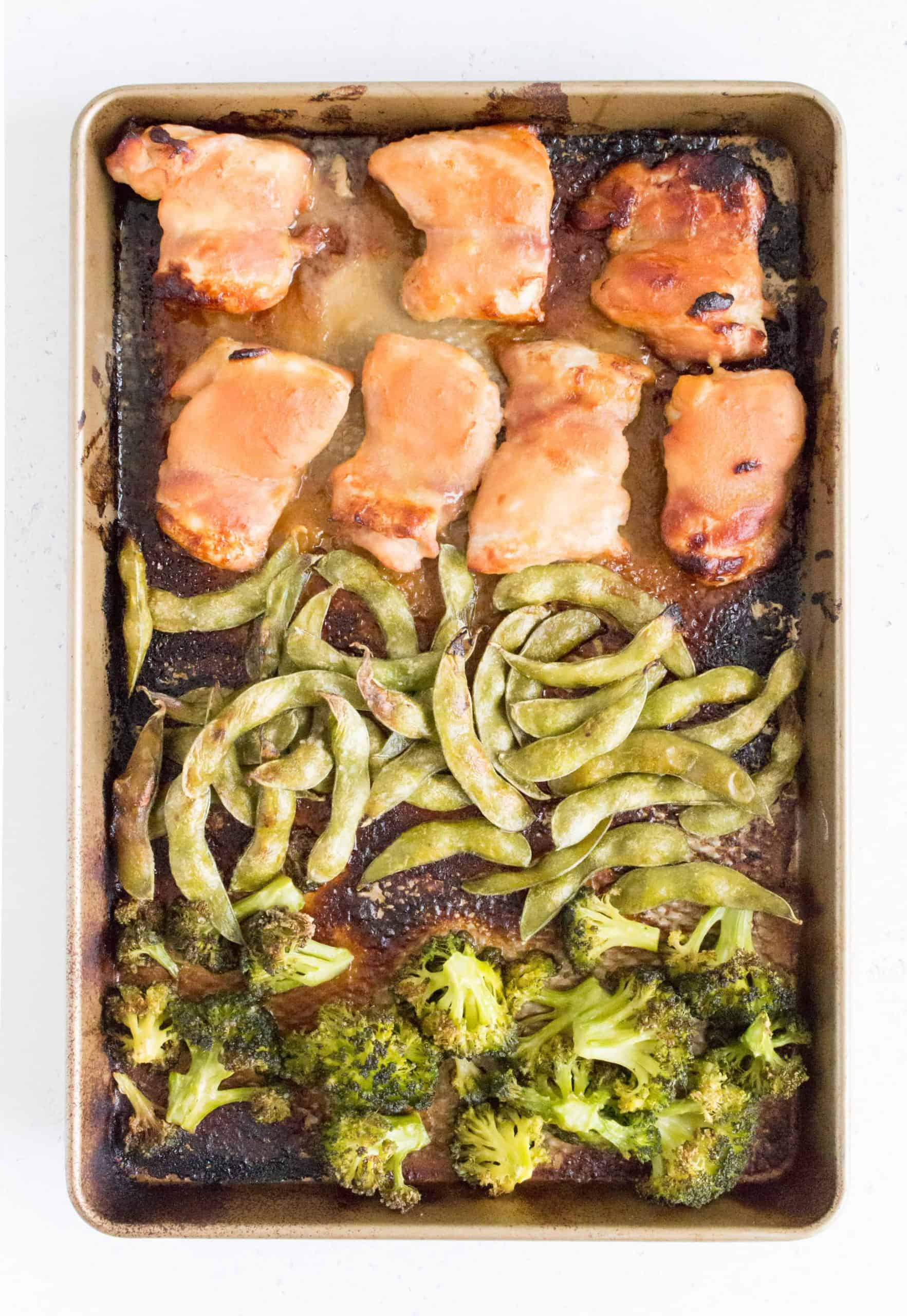 roasted miso chicken thighs with roasted edamame and broccoli in a sheet pan