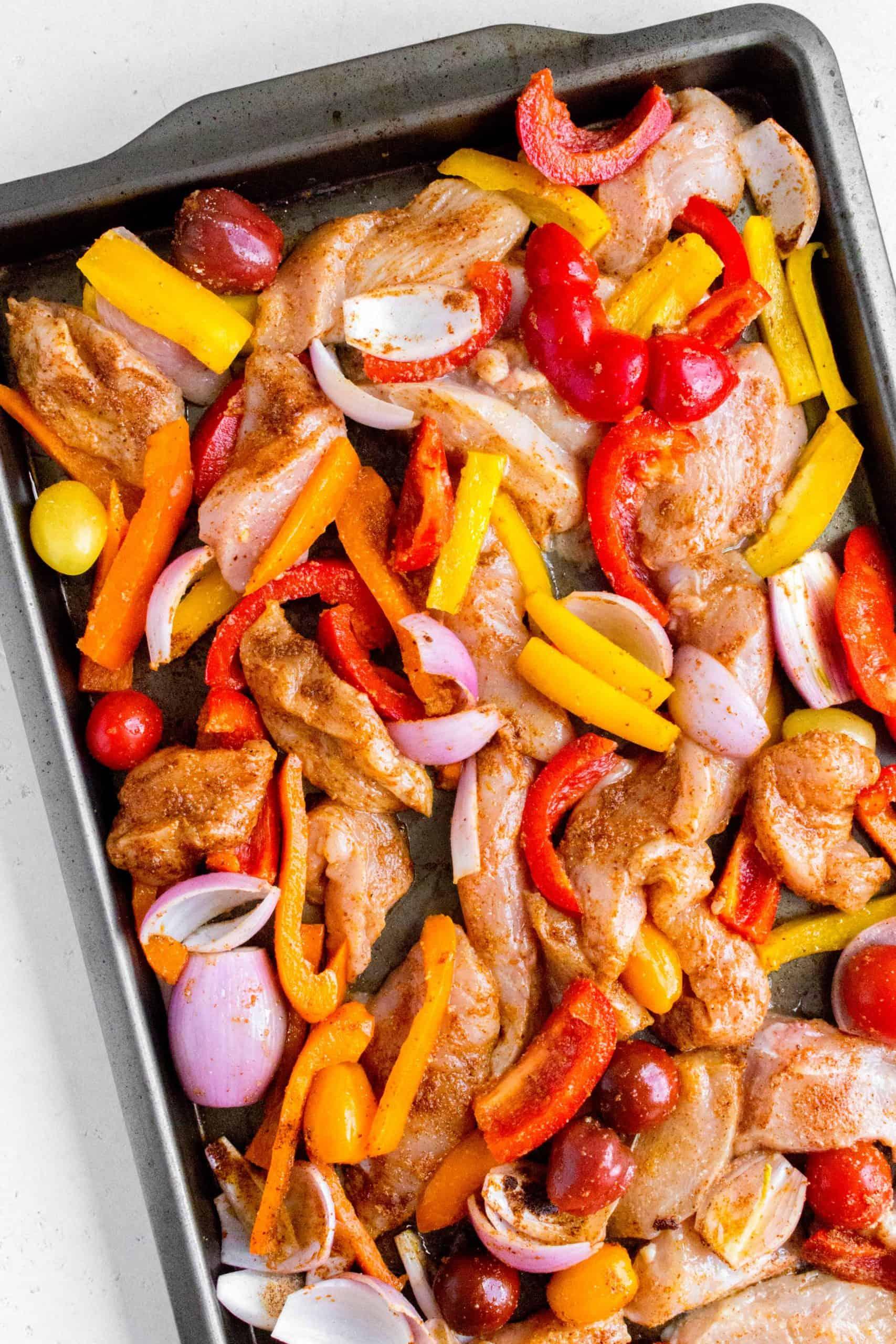 lime chili fajitas in a sheet pan before baking
