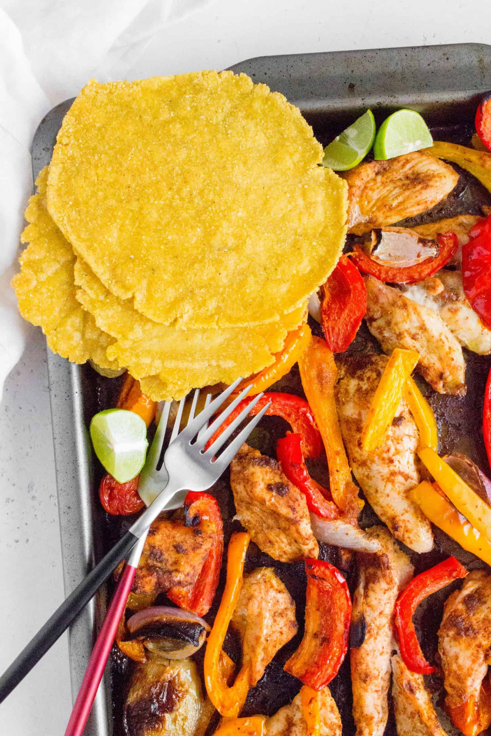 You're going to want to make this Sheet Pan Chili Lime Fajitas ASAP! This zesty chili lime seasoned chicken and veggies cook up in just 30 minutes and is the perfect weeknight dinner or as a meal prep!