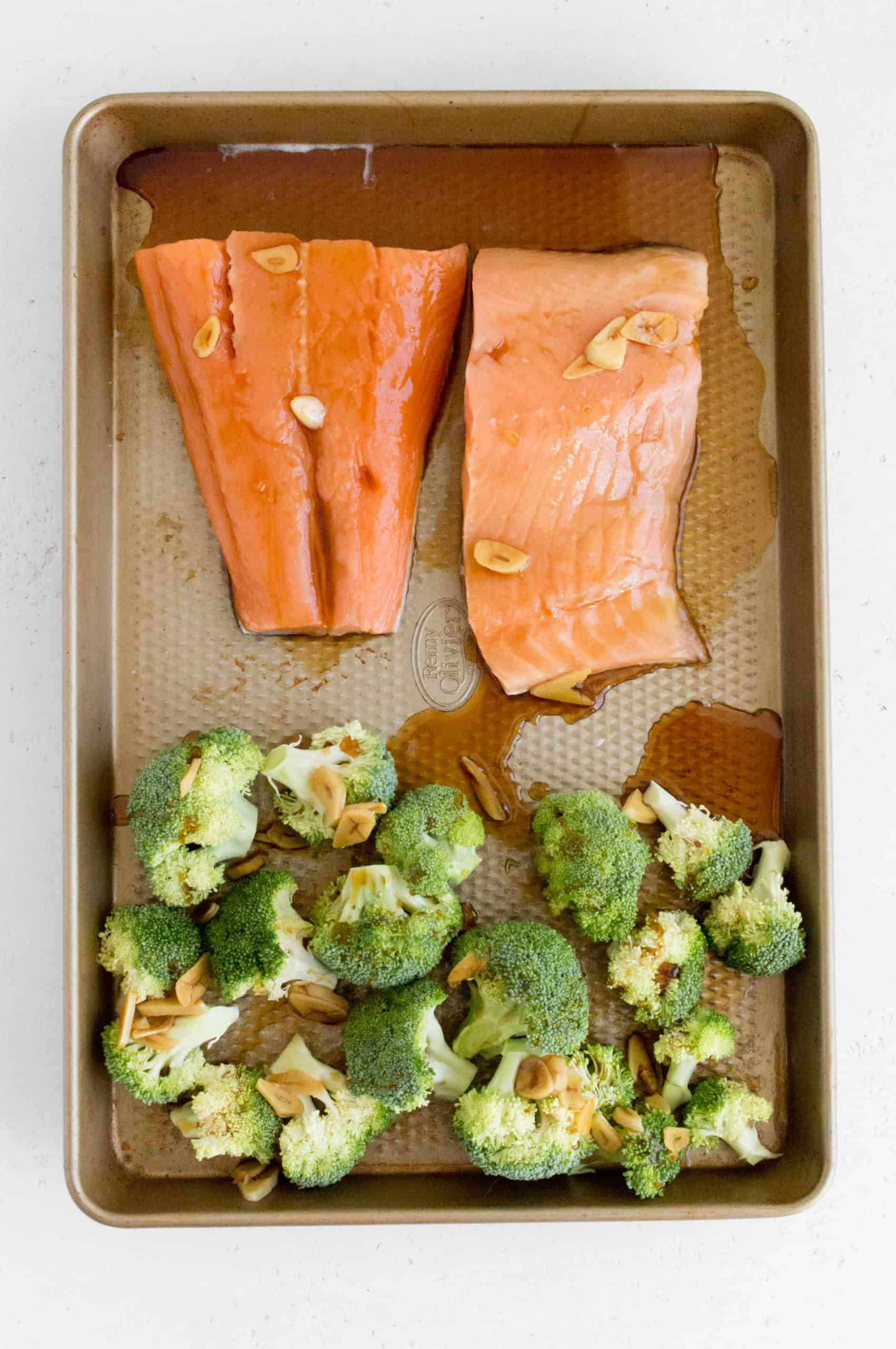 salmon and broccoli on sheet pan with teriyaki sauce on top