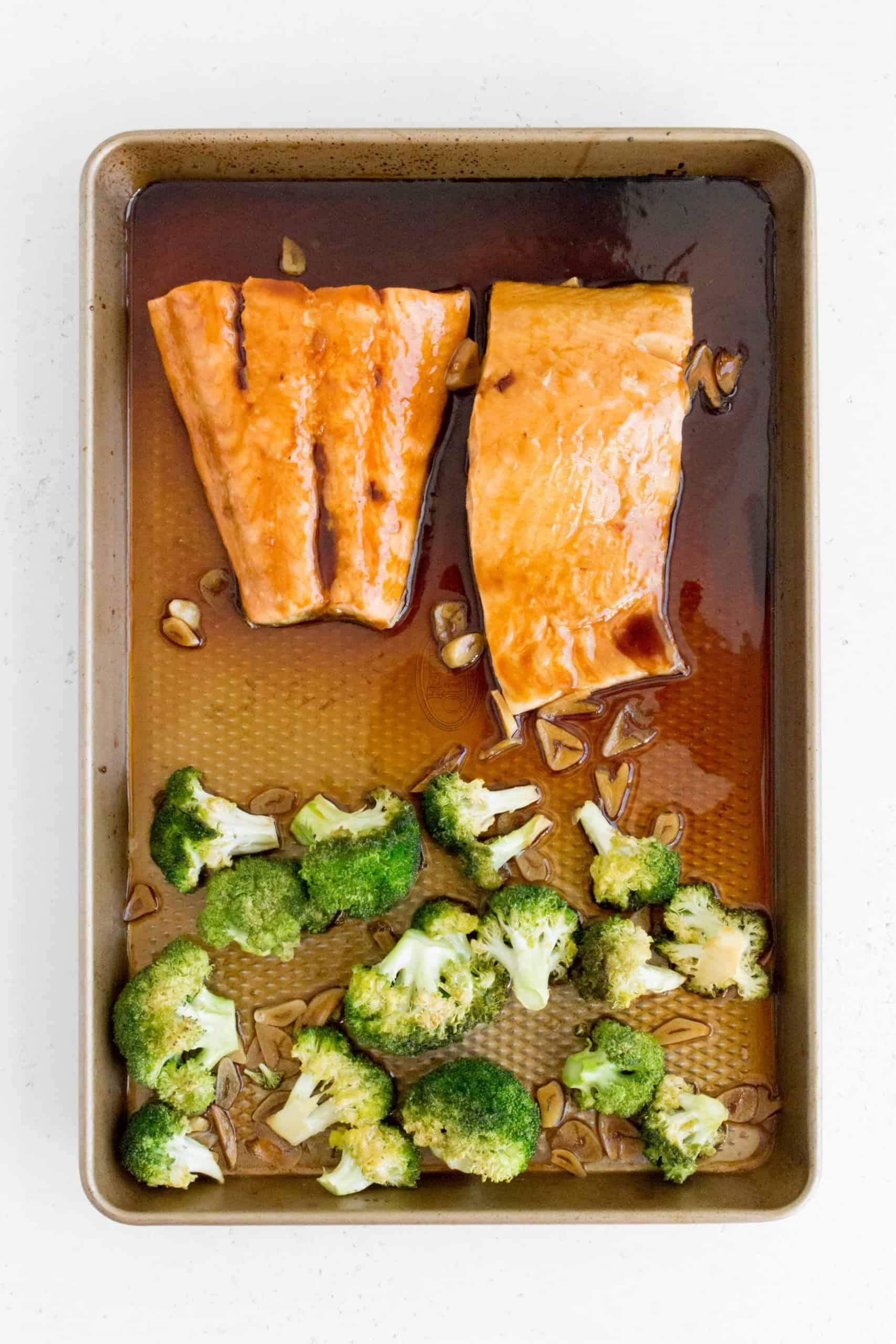 oven baked salmon teriyaki with broccoli in a sheet pan