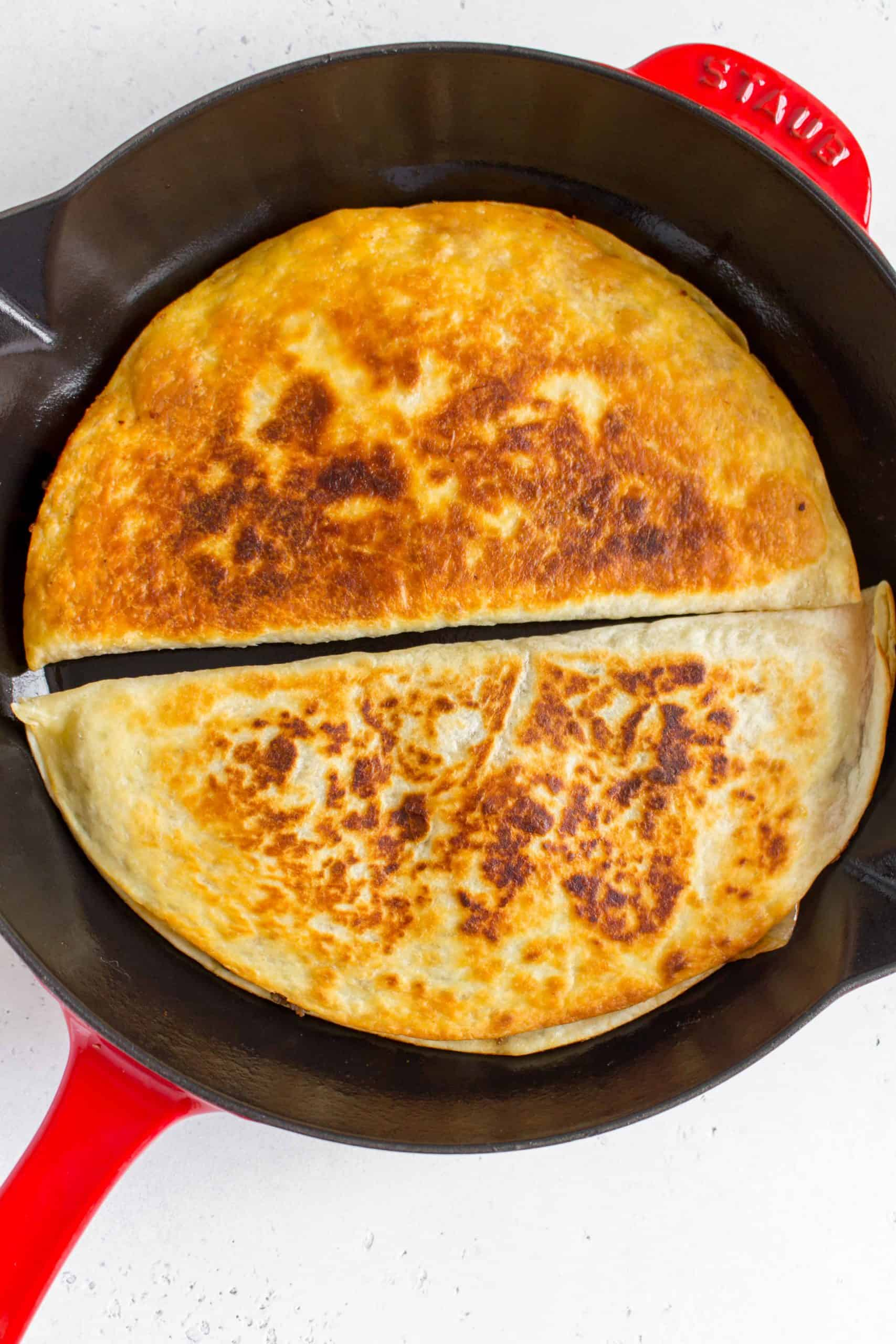 crispy and golden quesadillas in a staub pan