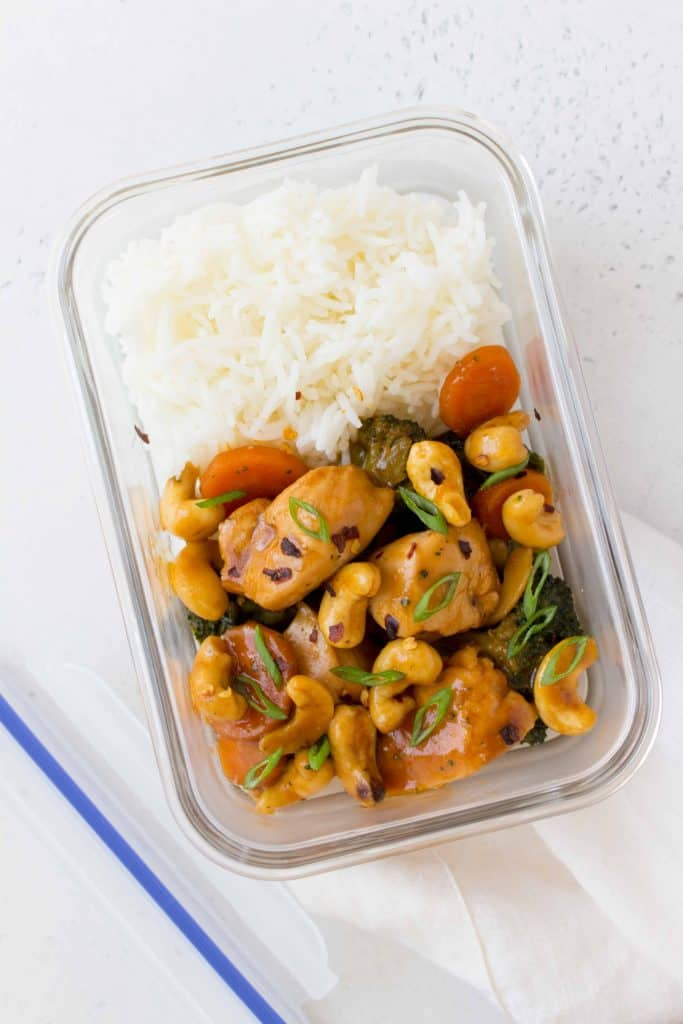 cashew chicken in a meal prep container with rice