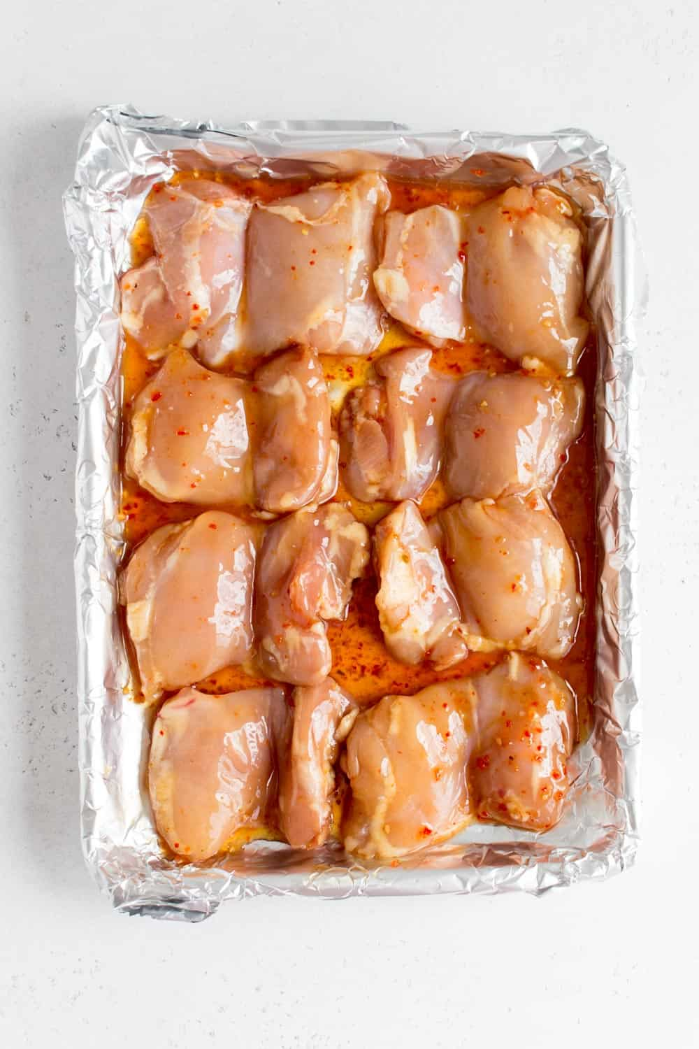 chicken thighs in a sheet pan with sweet thai chili marinade