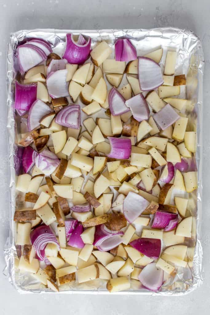 sheet pan with potatoes and onions