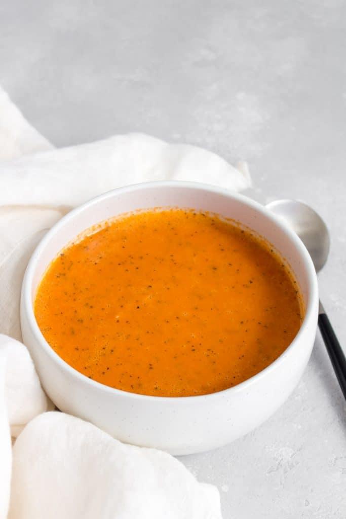 white bowl of tomato soup