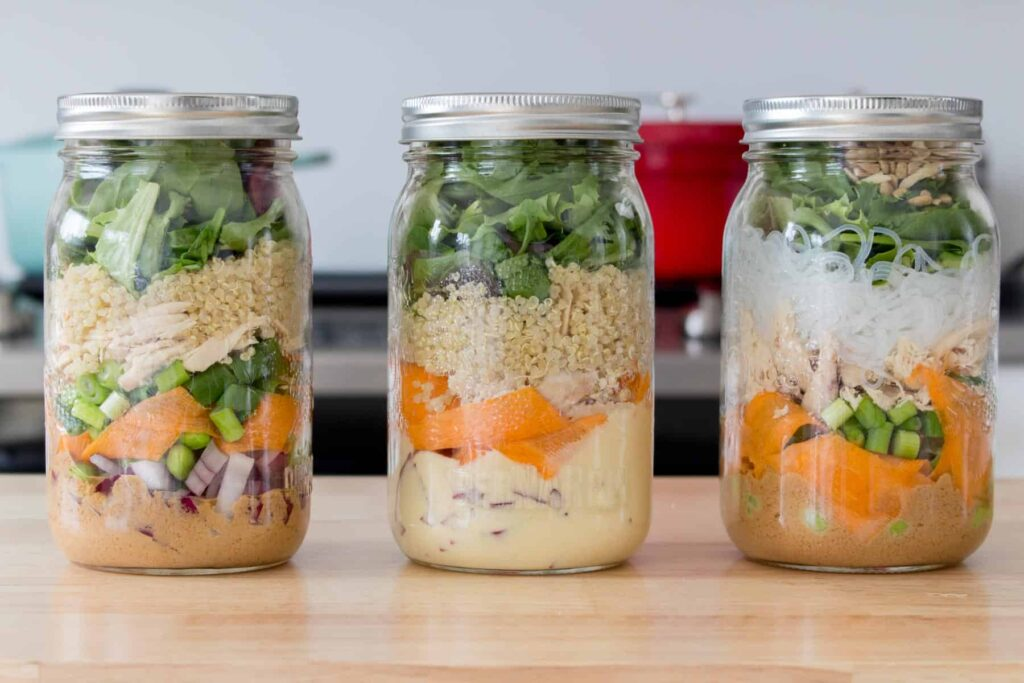 3 mason jars filled with mason jar salads