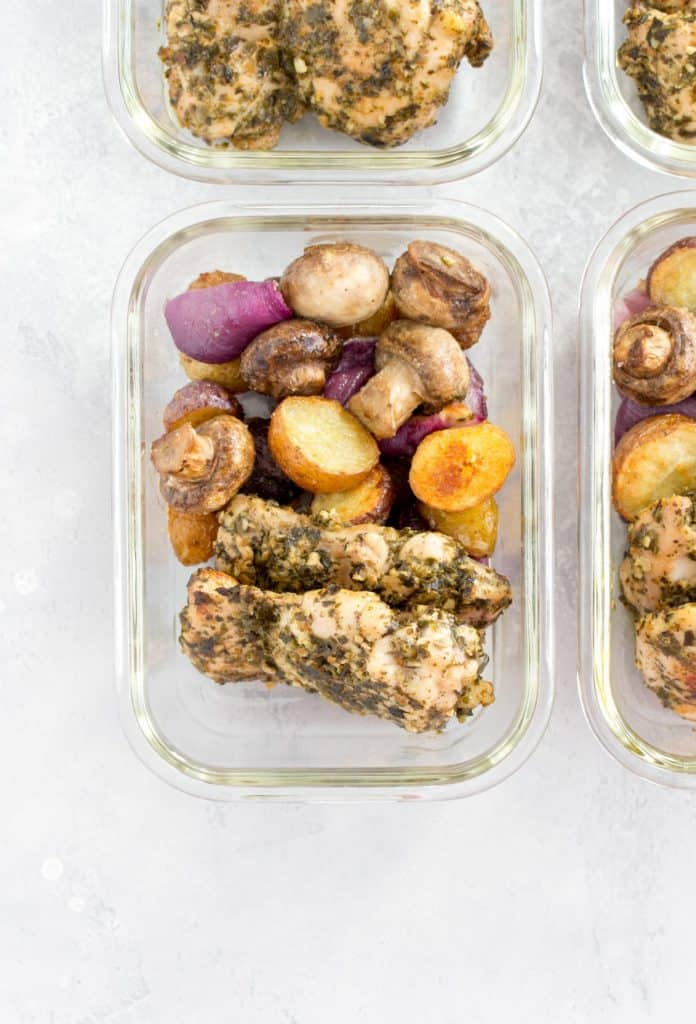 glass meal prep container with pesto chicken and vegetables