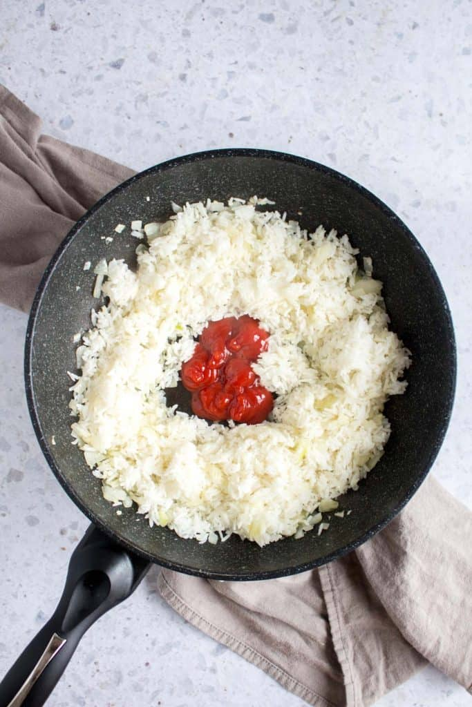 ketchup added to rice in frying pan