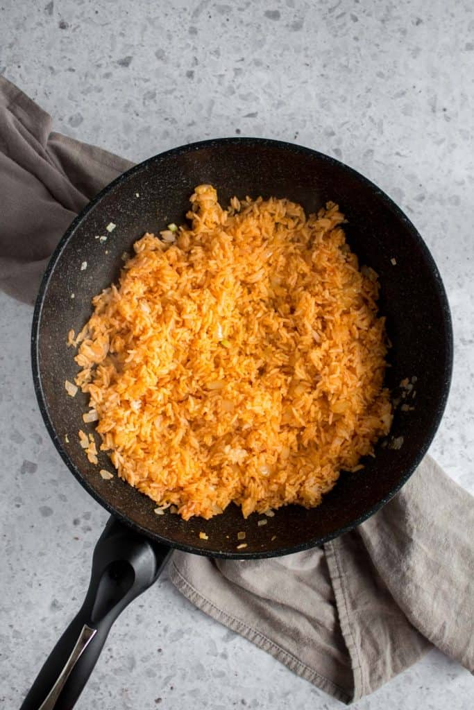 stir to combine ketchup and rice in frying pan