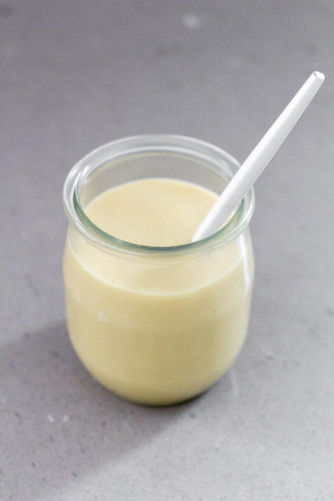 honey mustard dressing inside a small mason jar.