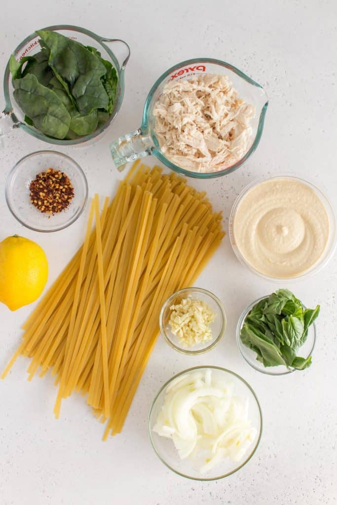 Overhead image of ingredients for hummus pasta.