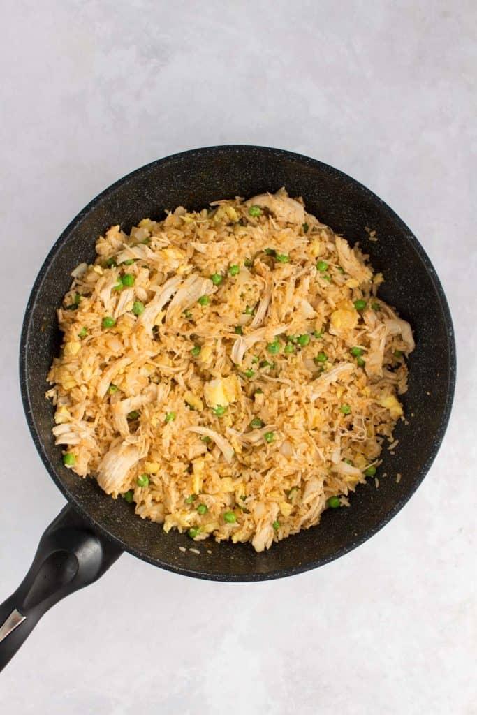 Sriracha fried rice in a wok.