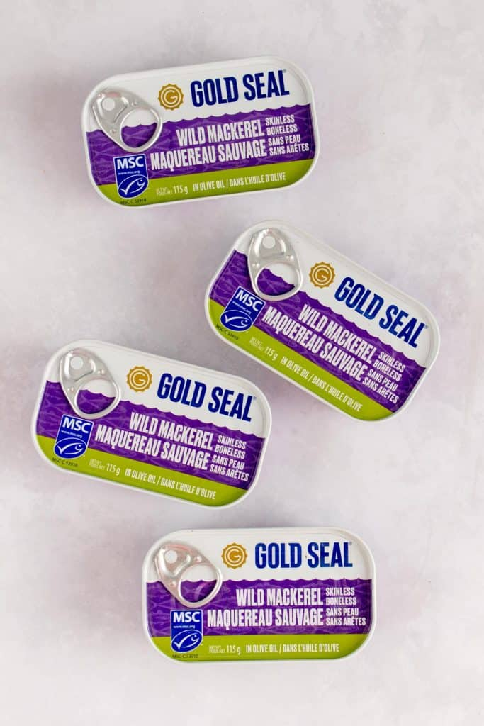 Four cans of Gold Seal Wild Mackerel.