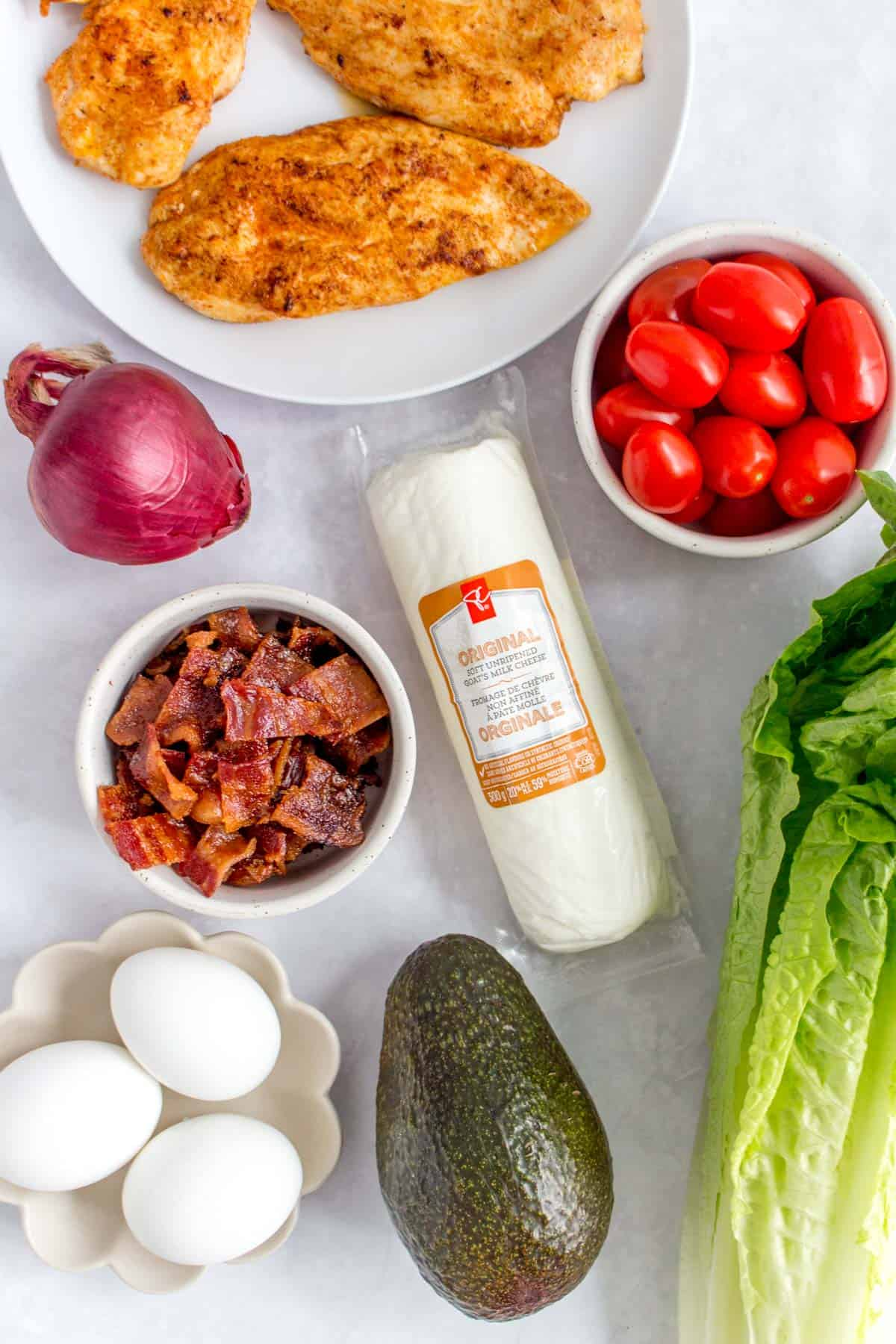Ingredients for a meal prepped chicken cobb salad.