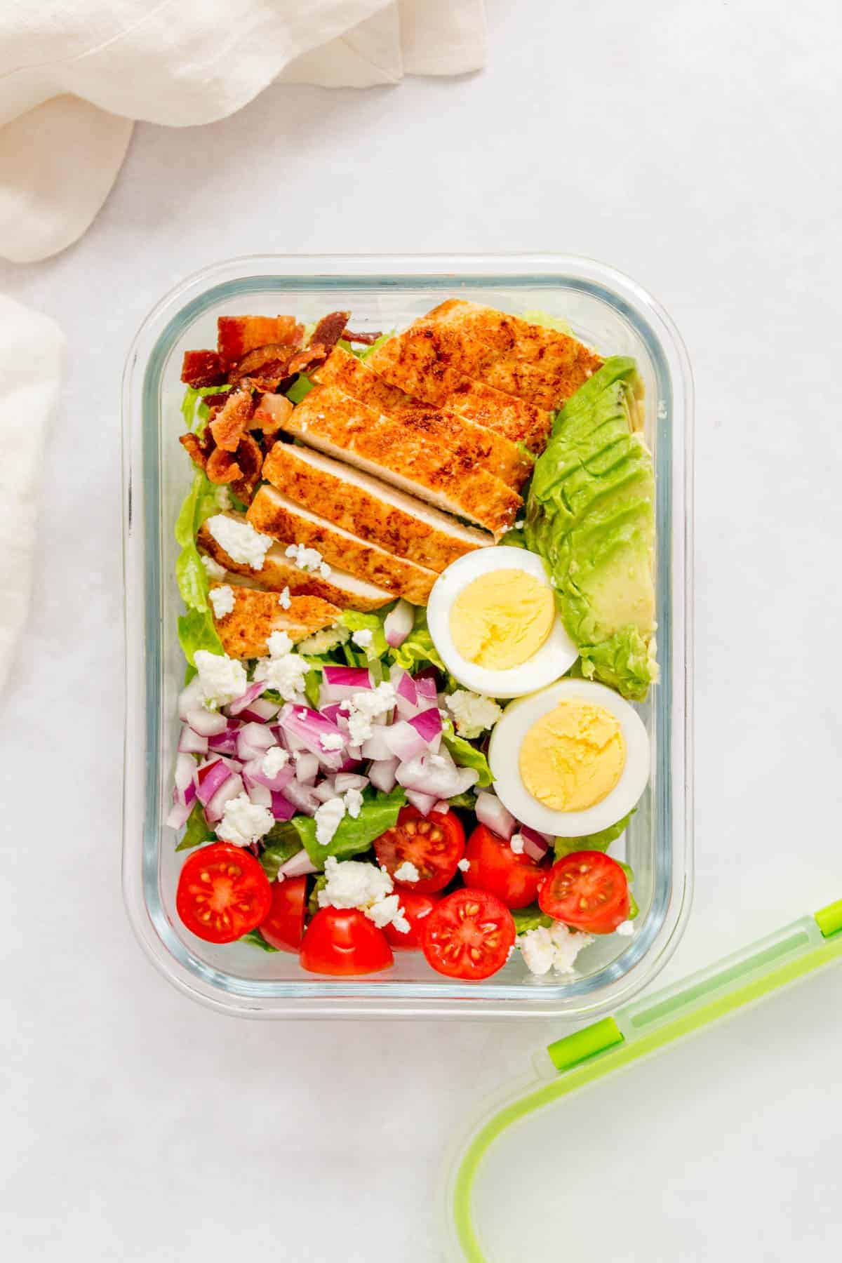 Packed with protein, this super easy healthy Chicken Cobb Salad doesn't take long to put together and is perfect if you're looking for a filling salad. It packs really well, making this cobb salad a perfect meal prep as well.