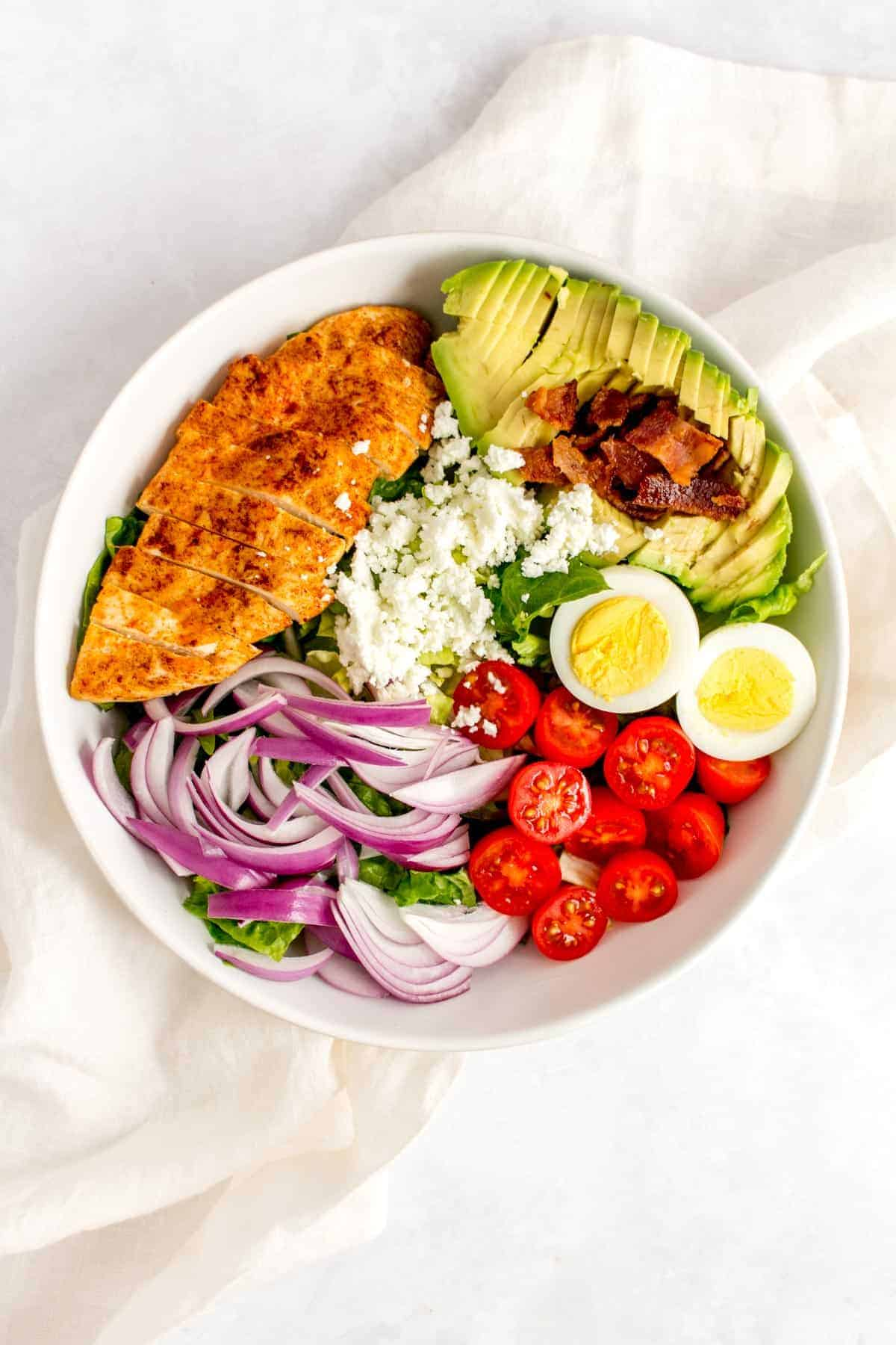 Overhead view of a bowl of chicken cobb salad.