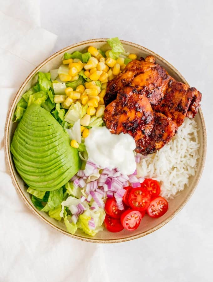 A chicken burrito bowl with honey chipotle chicken thighs.