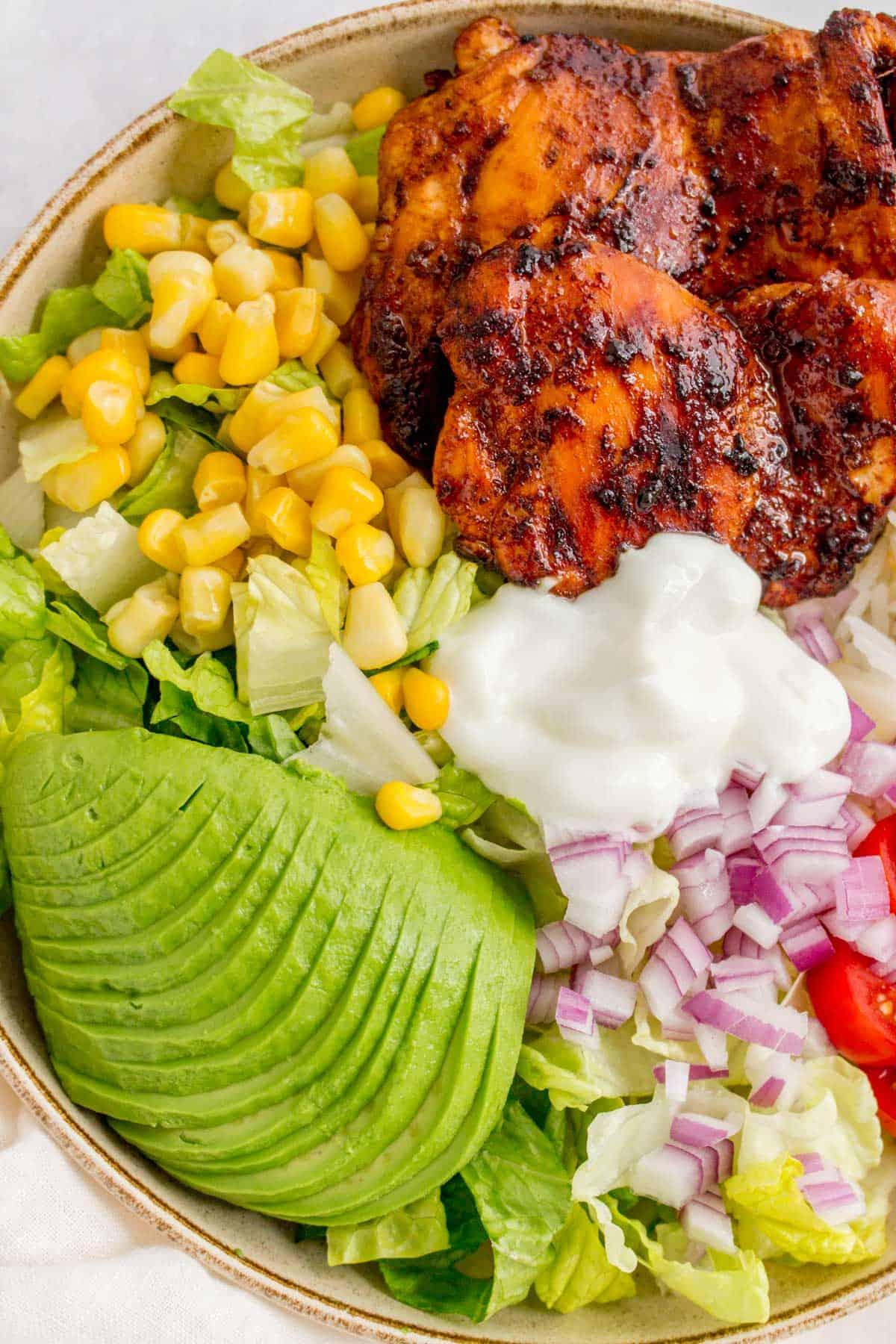 Close up of a honey chipotle chicken burrito bowl.