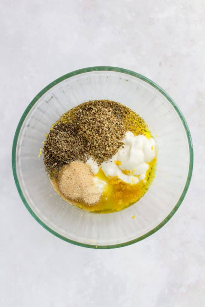 Ingredients for herb chicken marinade in a bowl.