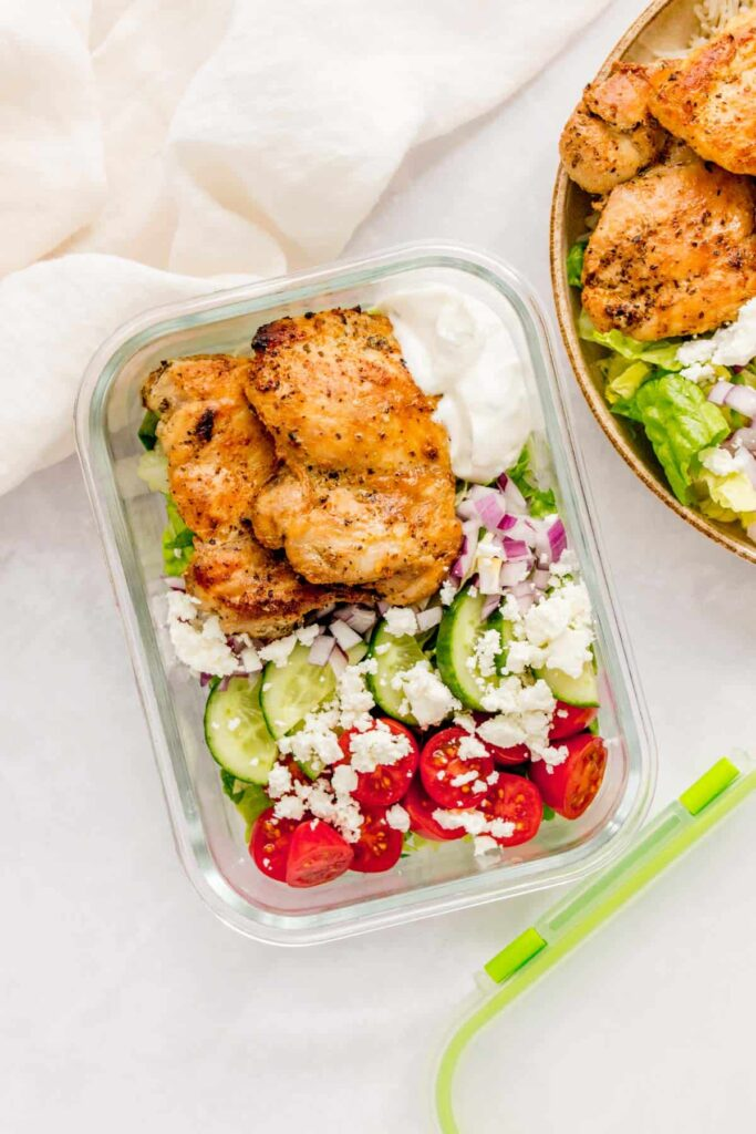 Herb chicken meal prep salad in a glass container.