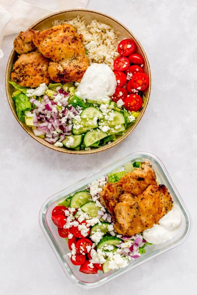 Herb chicken salad in a meal prep container and herb chicken rice bowl in a plate.