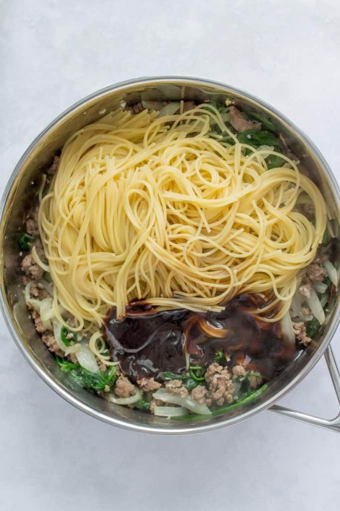 pan with noodles and sauce added.