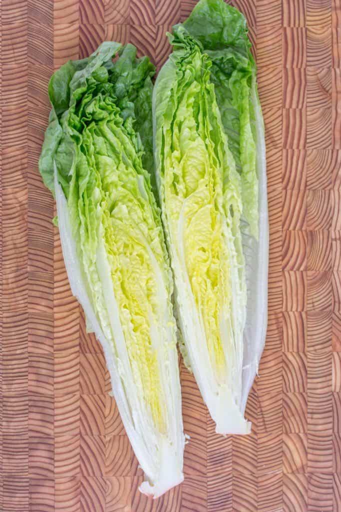 Romaine lettuce cut in half lengthwise.