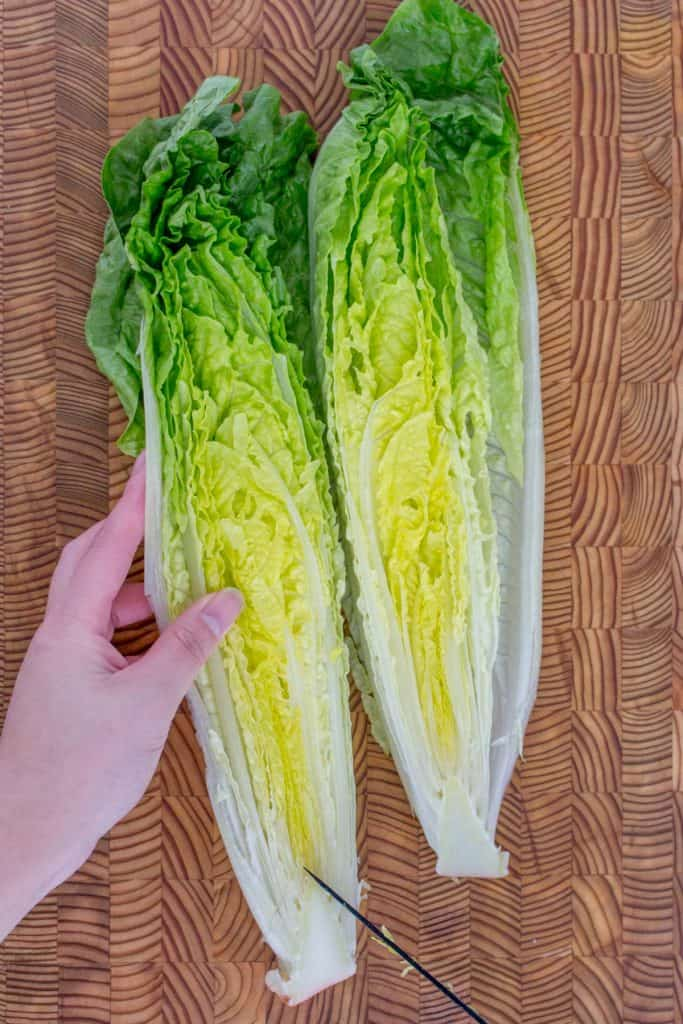 Cutting out the core of romaine lettuce.