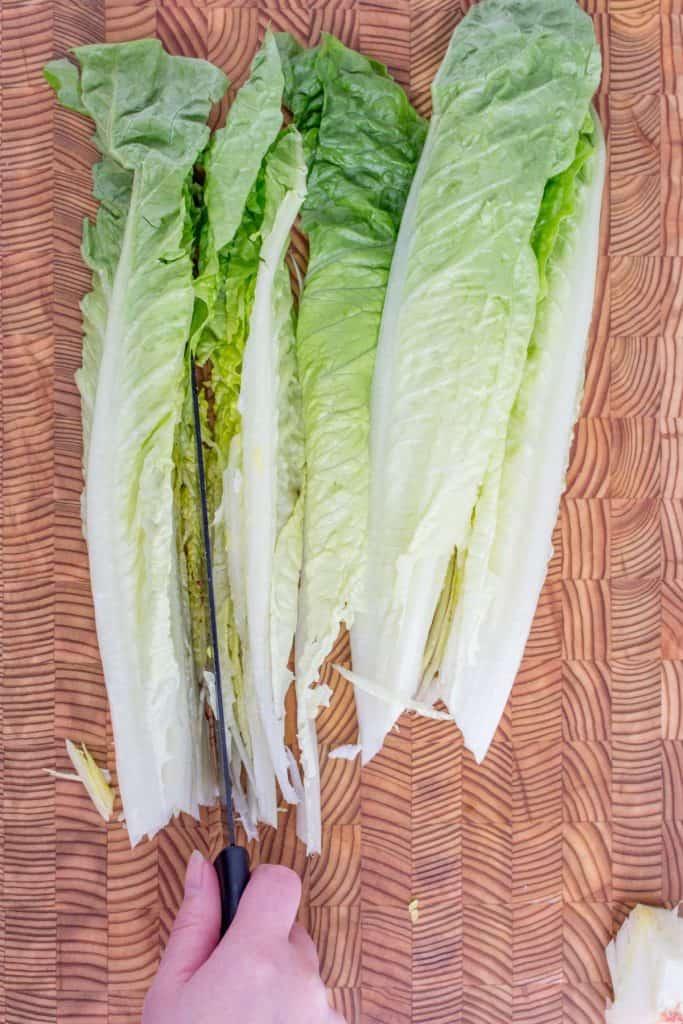 Cutting romaine lettuce into quarters.