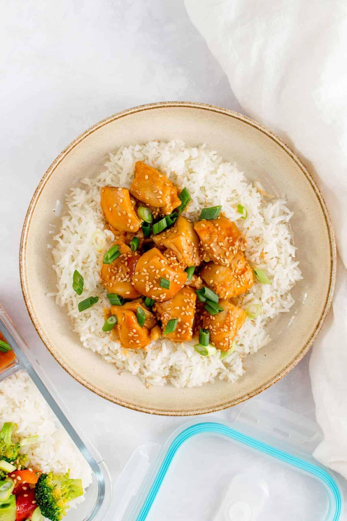 A plate of sesame chicken.