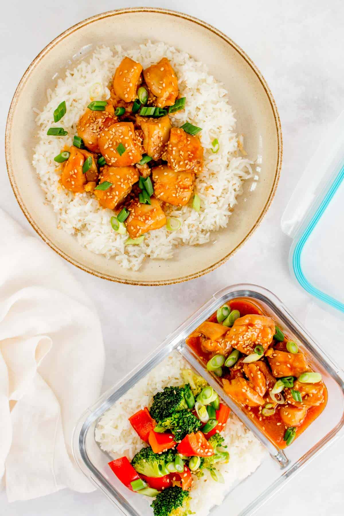 Instant pot sesame chicken in a plate and in a meal prep container.