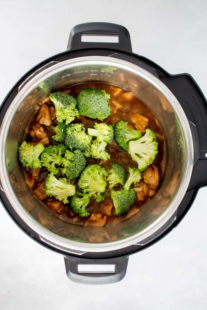 broccoli added to an instant pot.