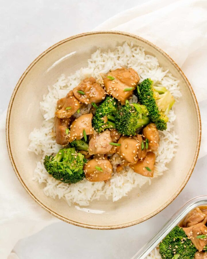 A bowl with rice topped with Instant Pot Asian chicken and broccoli.