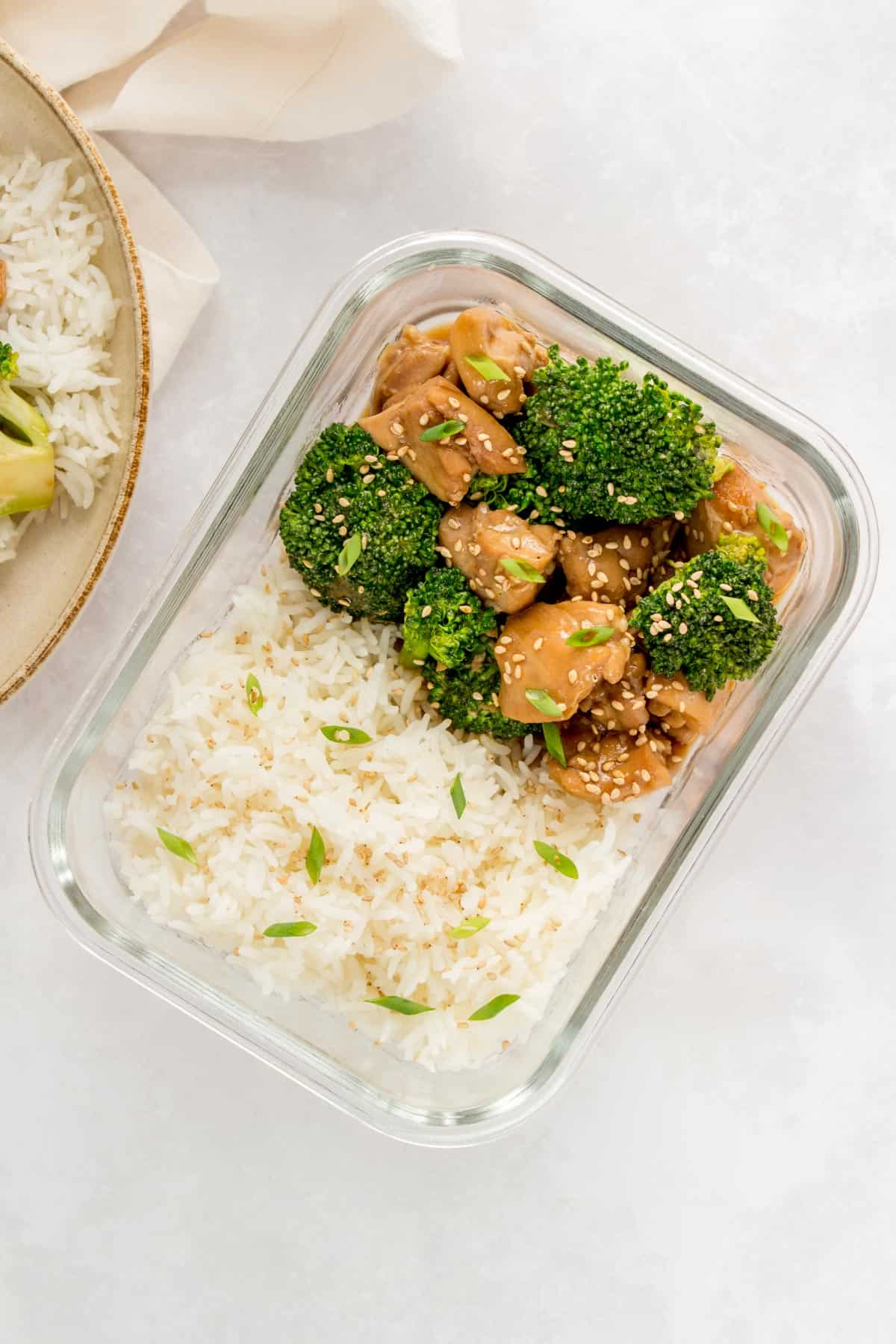 Meal prep container with chicken, rice, and broccoli.