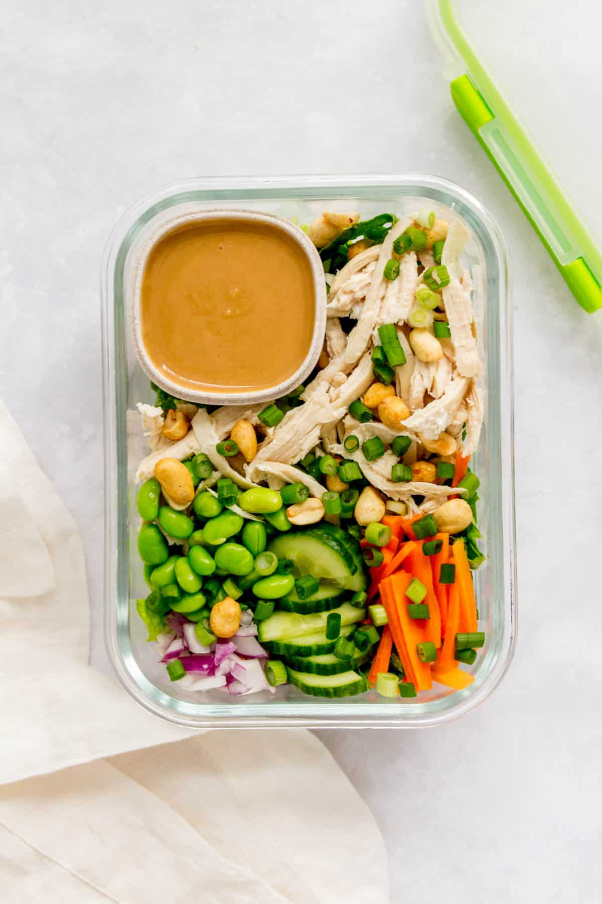 Meal prep container of thai chopped salad with peanut sauce.