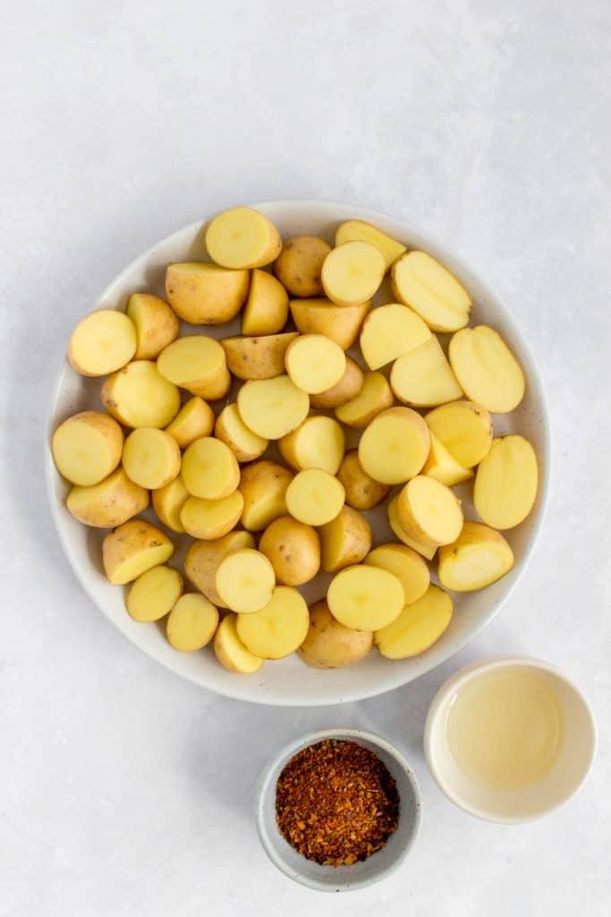 Overhead photo of baby potatoes and seasoning.