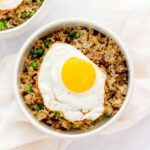 Bowl of beef fried rice with a fried egg on top.