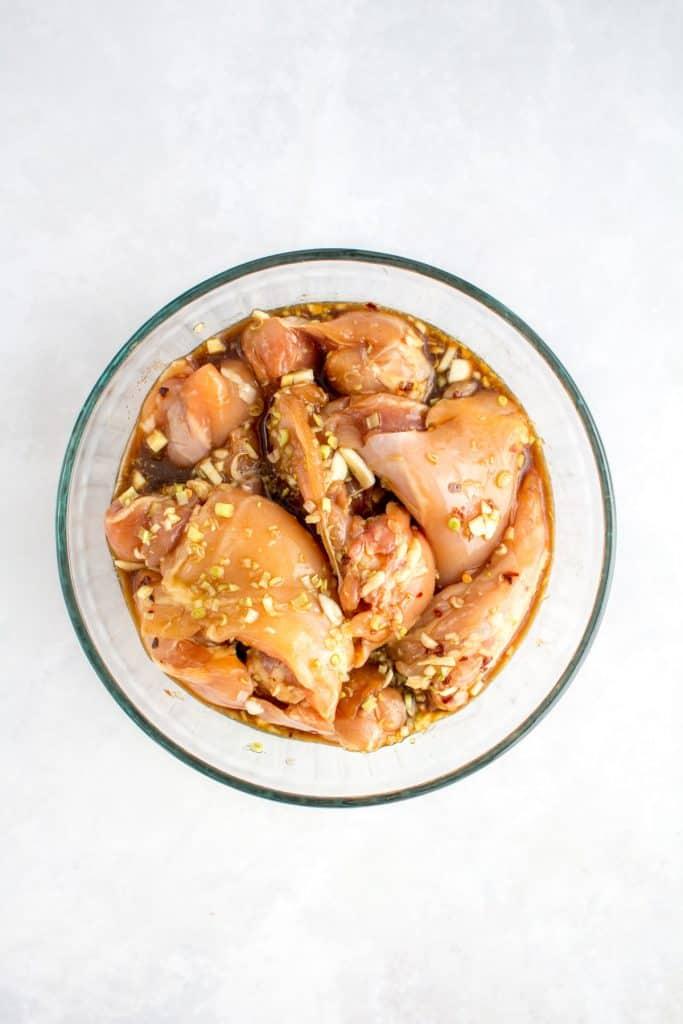 chicken thighs marinating in lemongrass marinade.