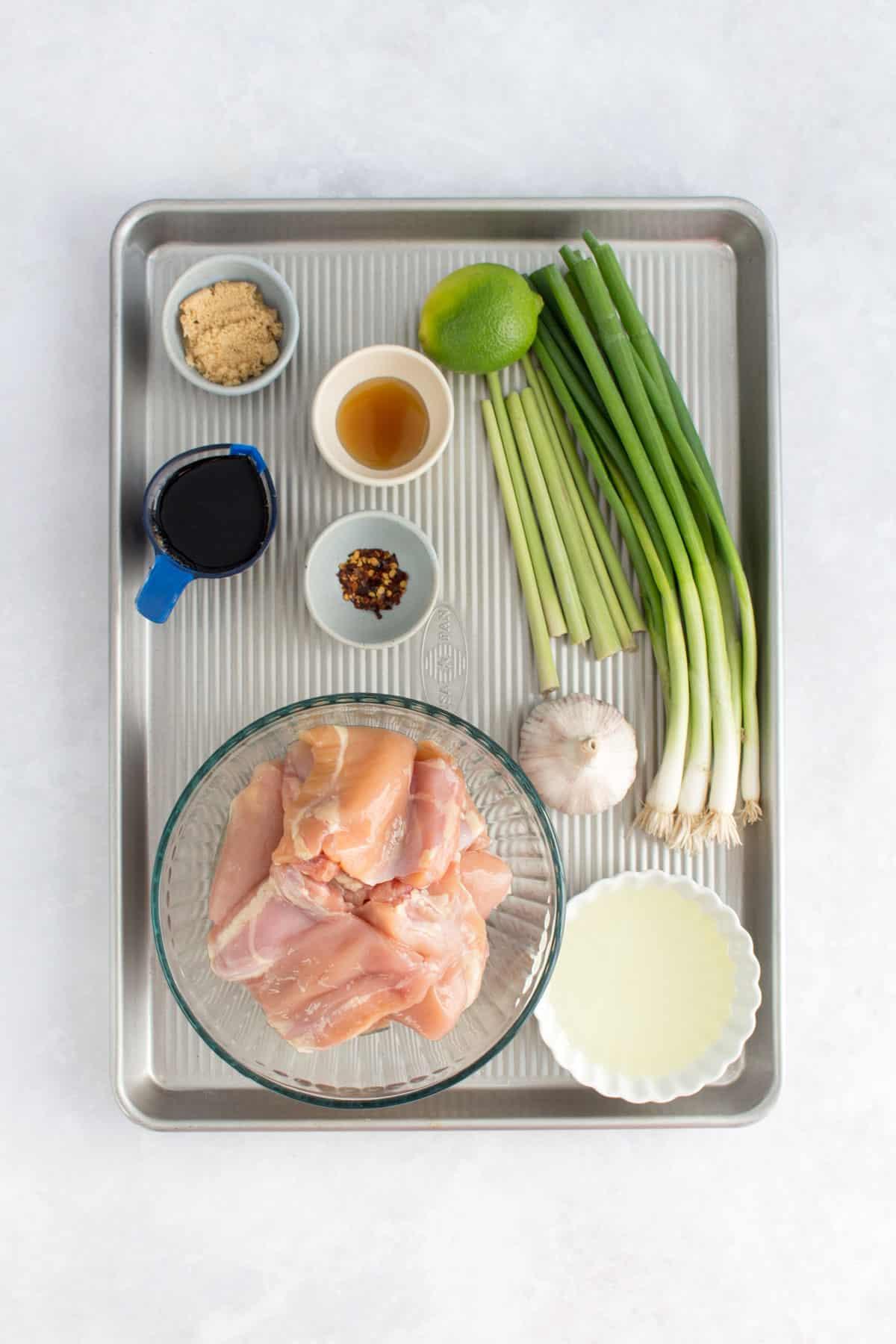 Ingredients for lemongrass chicken in a sheet pan.
