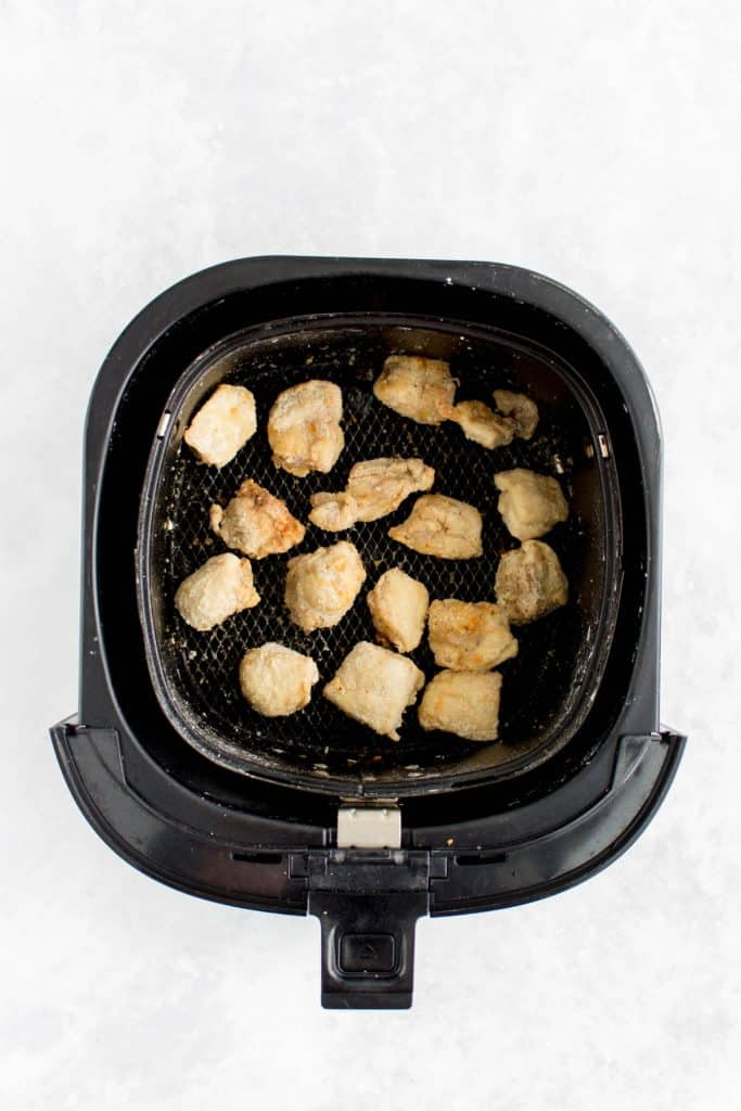 Crispy chicken pieces in the air fryer.