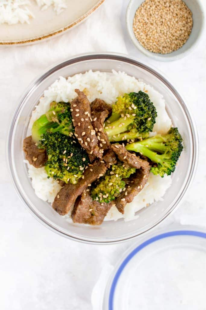 A meal prep container of rice and beef and broccoli.