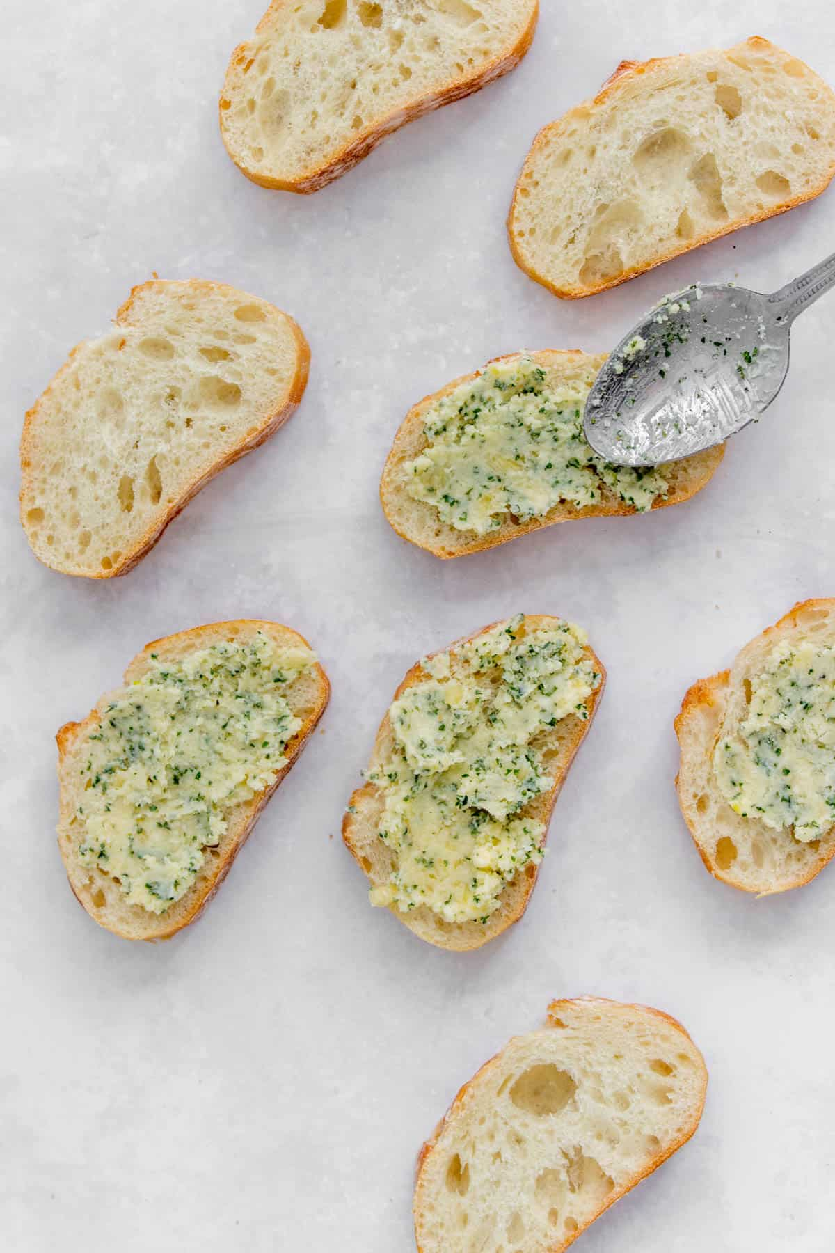 Baguette with garlic butter spread on.